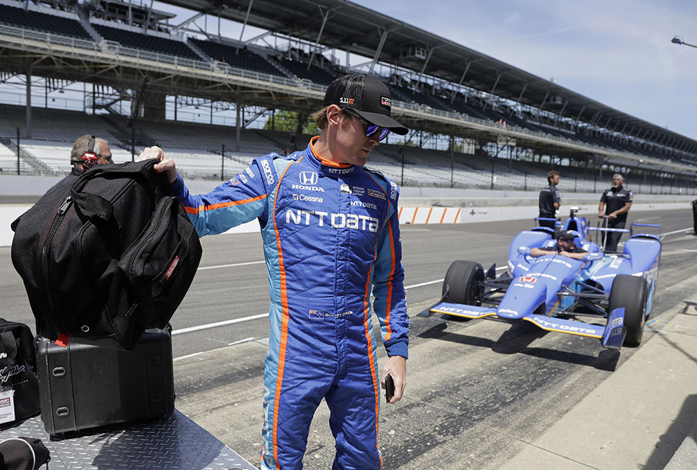 Scott Dixon, of New Zealand, grabs his helmet before the start of a practice session for the Indianapolis 500 IndyCar auto race at Indianapolis Motor Speedway, Monday.