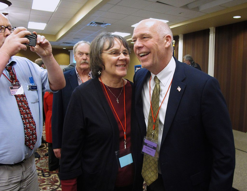 Greg Gianforte, right, receives congratulations from a supporter in Helena, Mont., on March 6. Gianforte won his election Thursday despite being charged with assault.