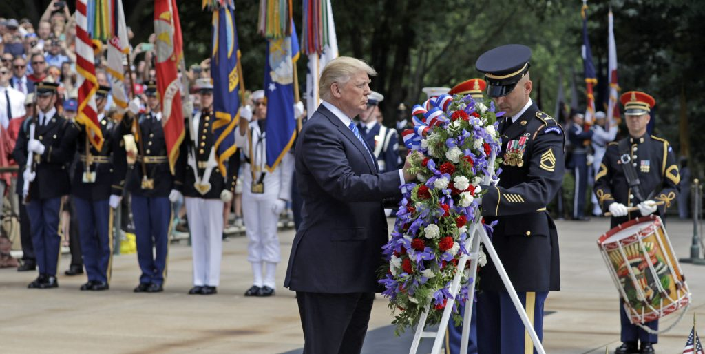 President Donald Trump lays a wreath at The Tomb of the Unknowns at Arlington National Cemetery Monday.