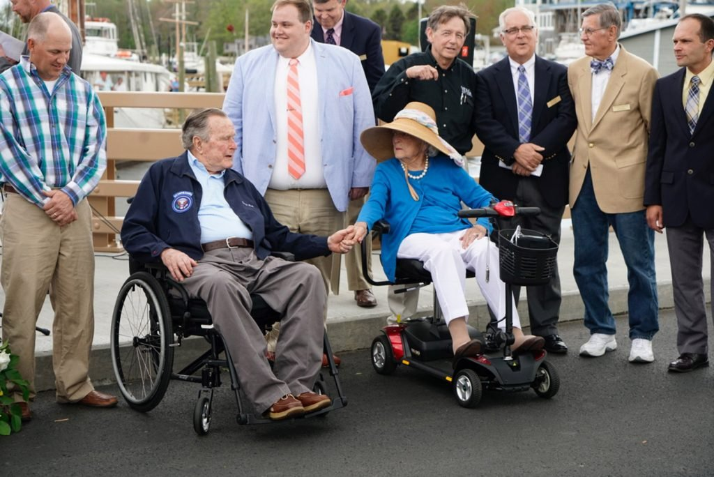 Former President George H.W. Bush and former first lady Barbara Bush hold hands while attending the rededication of the Mathew J. Lanigan Bridge over the Kennebunk River.