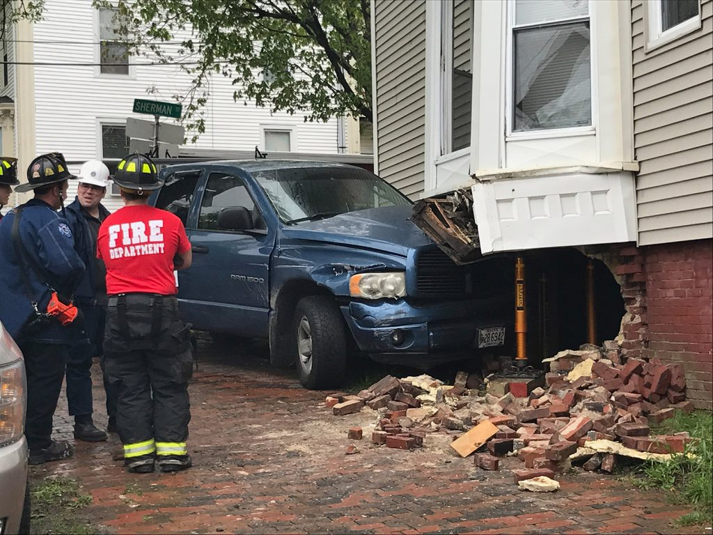 A pickup truck crashed into a building at High and Sherman streets in Portland on Friday afternoon.