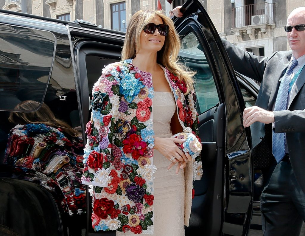 First lady Melania Trump wears a $51,000 Dolce & Gabbana jacket as she steps out of a car as she arrives at Chierici Palace, part of a visit of the G-7 first ladies in Catania, Italy, on Friday.