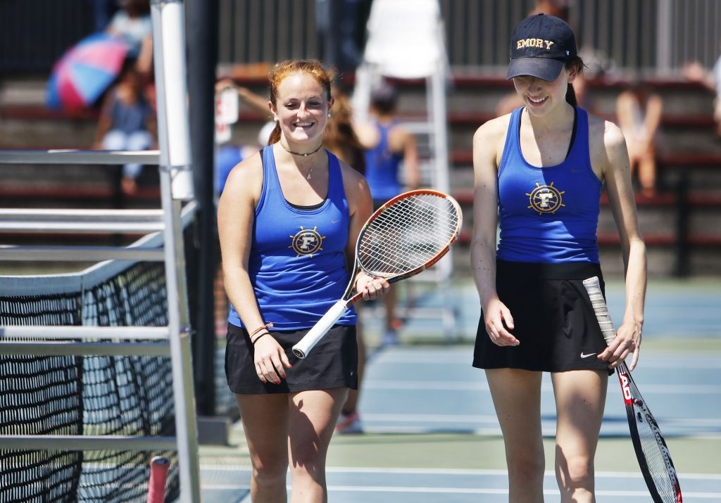"""Mary Hyland and Mia Cooney of Falmouth leave the court after their comeback win Thursday in the Class A South regional finals. Cooney, a senior, said The Streak is never far from her thoughts. """"You never want to be the one that breaks it,"""" she said."""