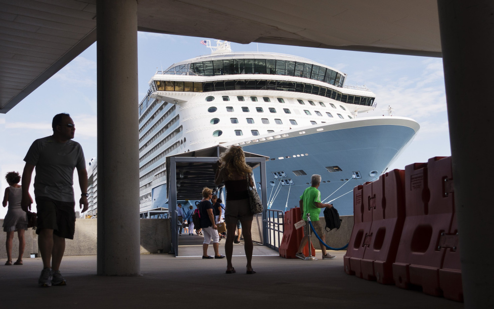Passengers walk near Anthem of the Seas when it was docked at the Ocean Gateway International Marine Terminal in Portland last year.