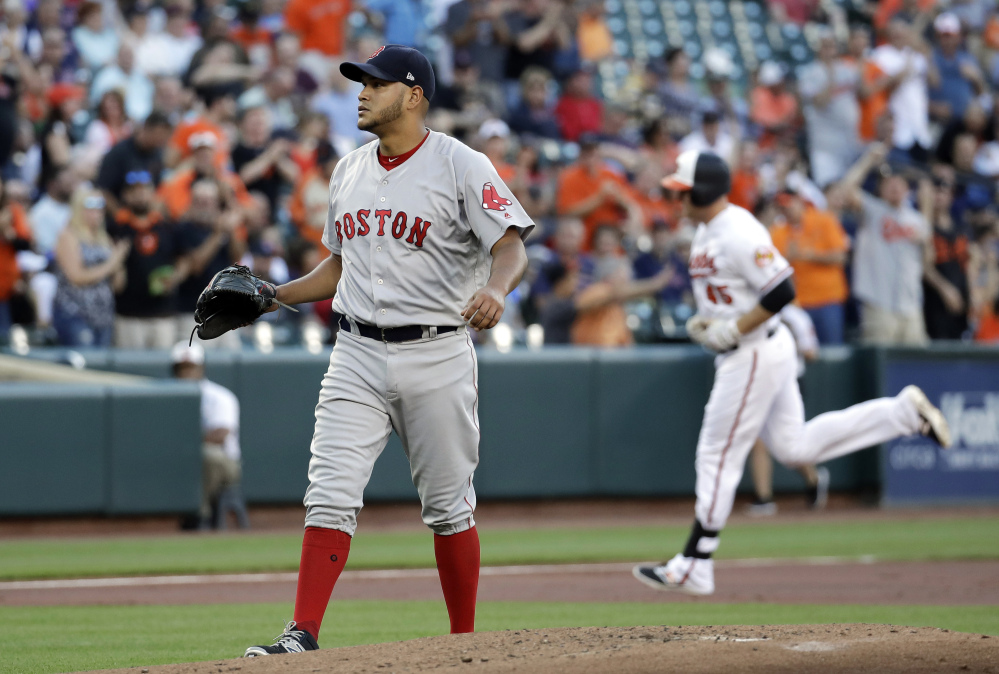 Red Sox starting pitcher Eduardo Rodriguez waits for Baltimore's Mark Trumbo to finish rounding the bases on a two-run home run during the first inning Thursday night in Baltimore.