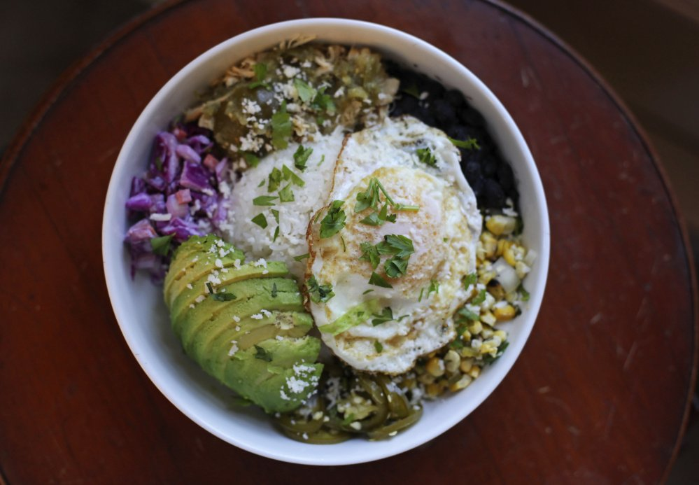 Baja bowl with avacado, salsa verde chicken and fried egg.