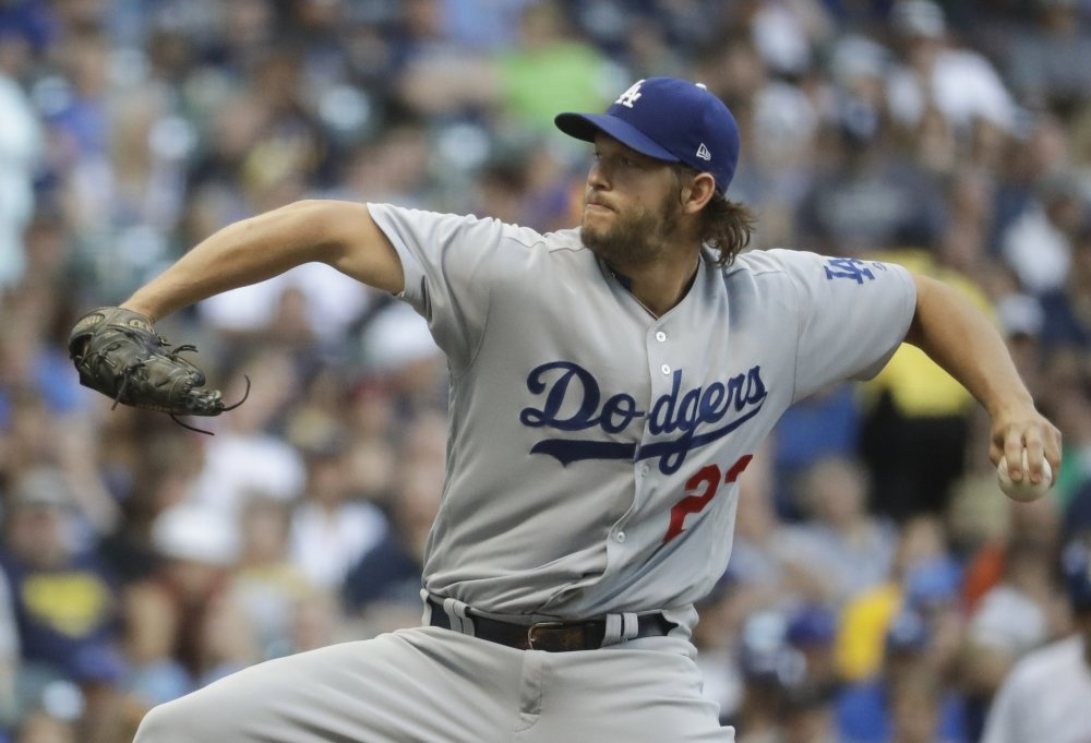 Clayton Kershaw of the Los Angeles Dodgers struck out 14 in seven innings Friday night against the Milwaukee Brewers, including the 2,000 of his career.