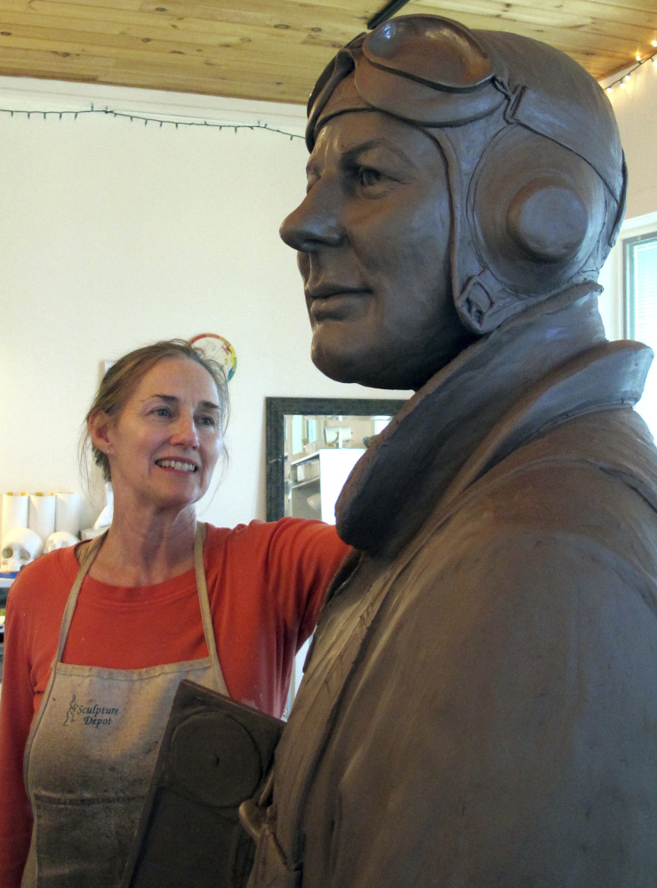 Sculptor Susan Geissler works on a clay likeness of World War II hero C. Wade McClusky Jr. in her Youngstown, N.Y., studio. The clay model will form the basis for a bronze monument planned for the Buffalo and Erie County Naval & Military Park in McClusky's hometown of Buffalo, N.Y. A dedication ceremony is scheduled for Sunday, the 75th anniversary of the Battle of Midway.