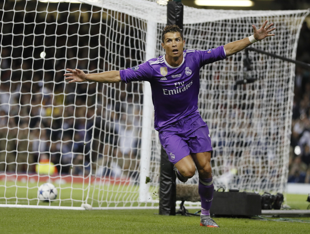 Cristiano Ronaldo of Real Madrid celebrates Saturday night after scoring during the 4-1 victory against Juventus in the Champions League final at Cardiff, Wales. Real Madrid has won a record 12 European championships.