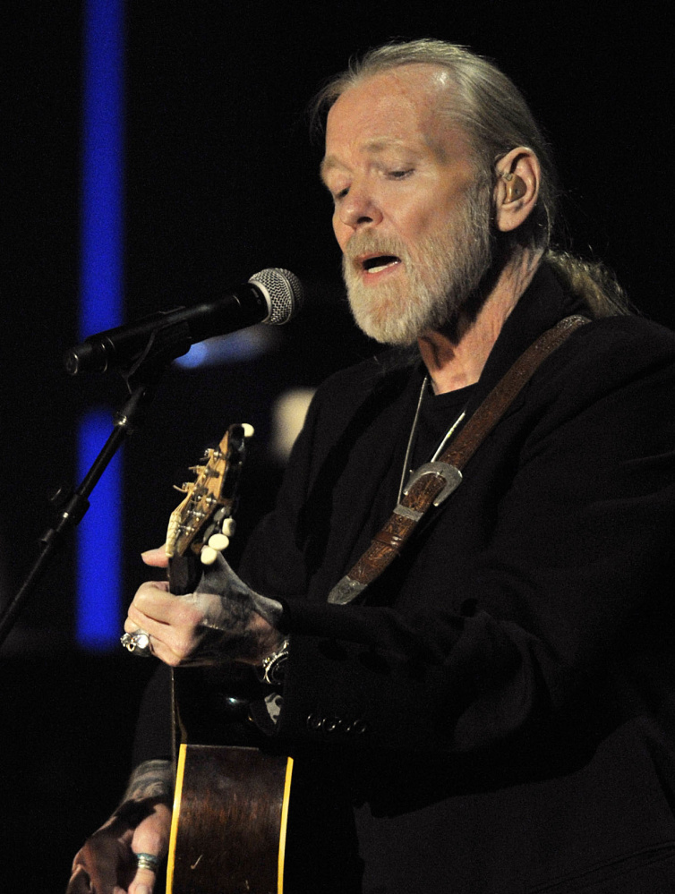 Gregg Allman plays guitar in Nashville in 2011.