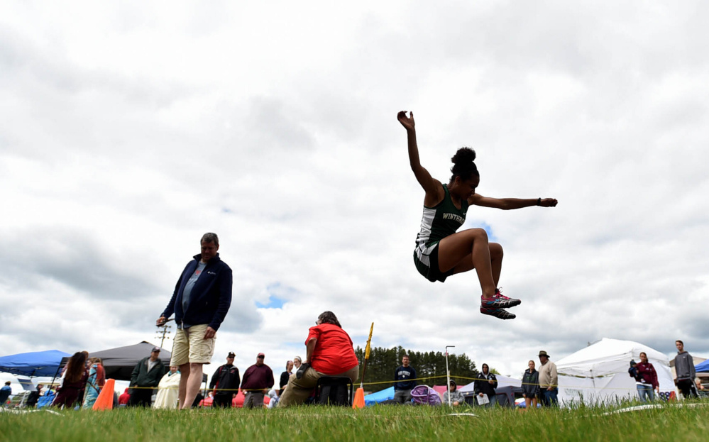 Staff photo by Michael G. Seamans Winthrop's Aaliyah Wilson Falcone competes in the long jump during the Class C track and field state championships Saturday at Foxcroft Academy. Falcone finished sixth.