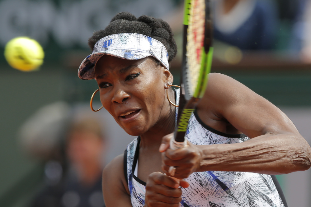 Venus Williams plays a shot during her 5-7, 6-2, 6-1 loss to 30th-seeded Timea Bacsinszky iun the fourth round at the French Open on Sunday in Paris, France.