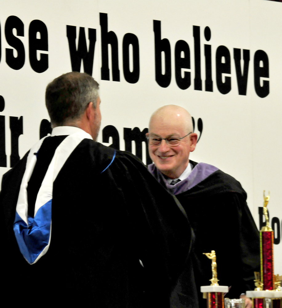 Maine Central Institute Headmaster Christopher Hopkins, left, introduces commencement speaker Norbert Young Jr., class of 1966, during commencement in Pittsfield on Sunday.