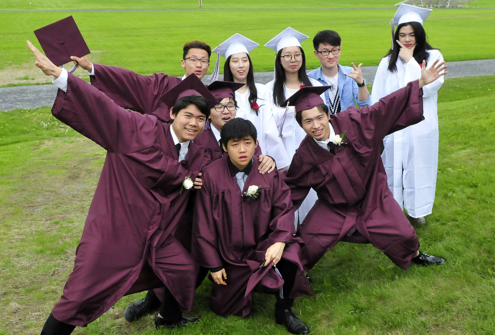 Maine Central Institute students pose for another student taking a group photo before commencement in Pittsfield on Sunday.