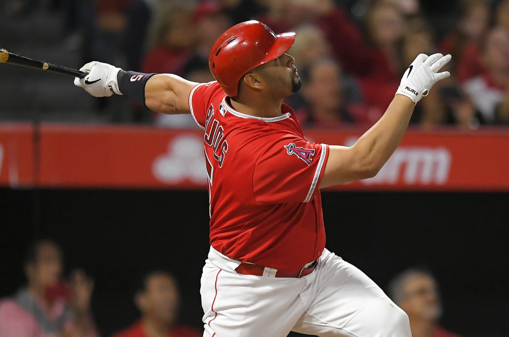 Albert Pujols of the Angels watches his 600th career home run – a grand slam Saturday night against Minnesota Twins and former teammate Ervin Santana.
