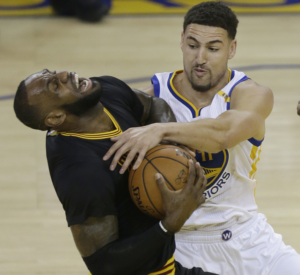 Associated Press/Ben Margot Klay Thompson fouls Cleveland's LeBron James, who did his best to give the Cavaliers a chance by recording a triple-double, but Cleveland returns home in a 2-0 hole.