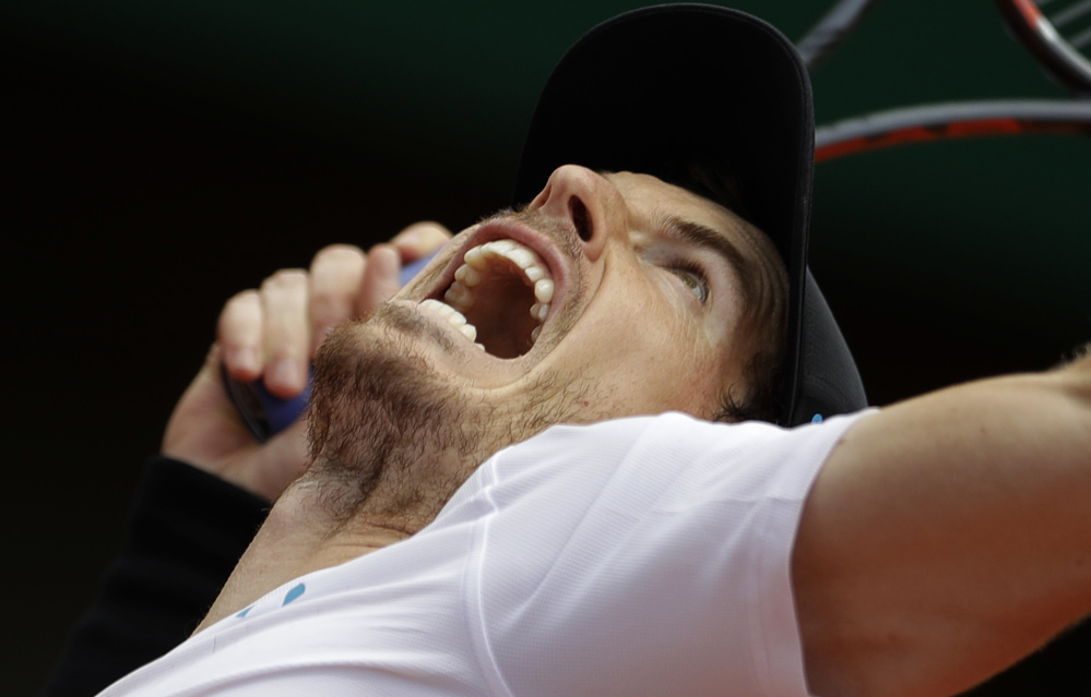 Top-seeded Andy Murray cruised into the French Open quarterfinals with a 6-3, 6-4, 6-4 win Monday over Karen Khachanov. Seven of the top eight men's seeds advanced to the quarterfinals.
