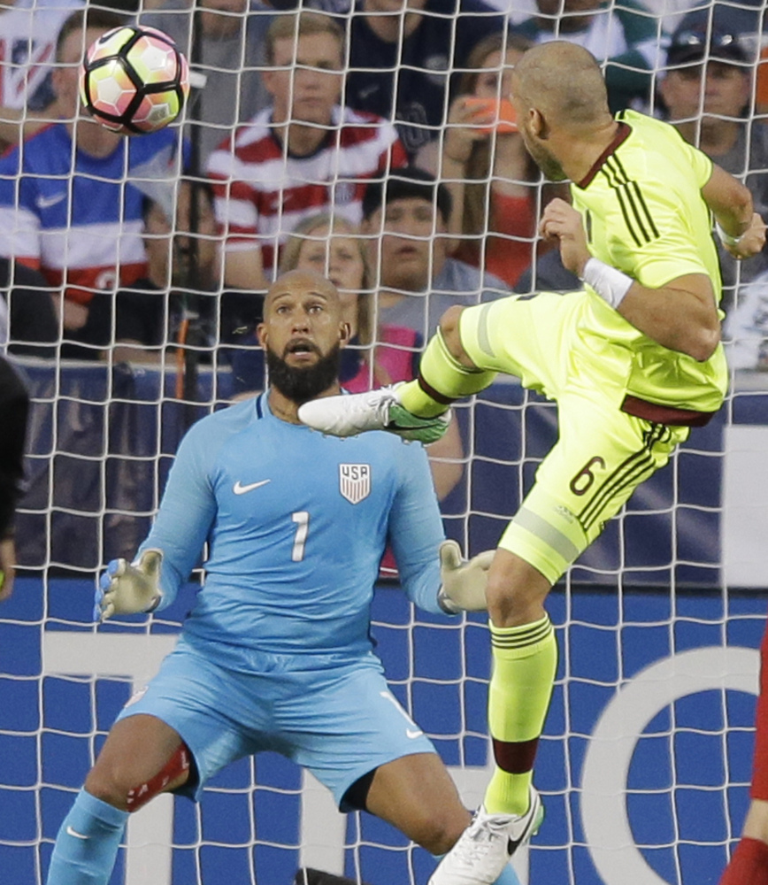 Tim Howard couldn't stop this header by Venezuela's Jose Manuel Velazquez, and the U.S. settled for a 1-1 draw Saturday in Sandy, Utah, as the team tuned up for Thursday's World Cup qualifier against Trinidad and Tobago.