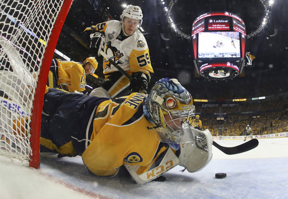Nashville goalie Pekka Rinne stops a shot by Pittsburgh center Jake Guentzel in the second period of Game 4 of the Stanley Cup Final on Monday night in Nashville, Tenn.