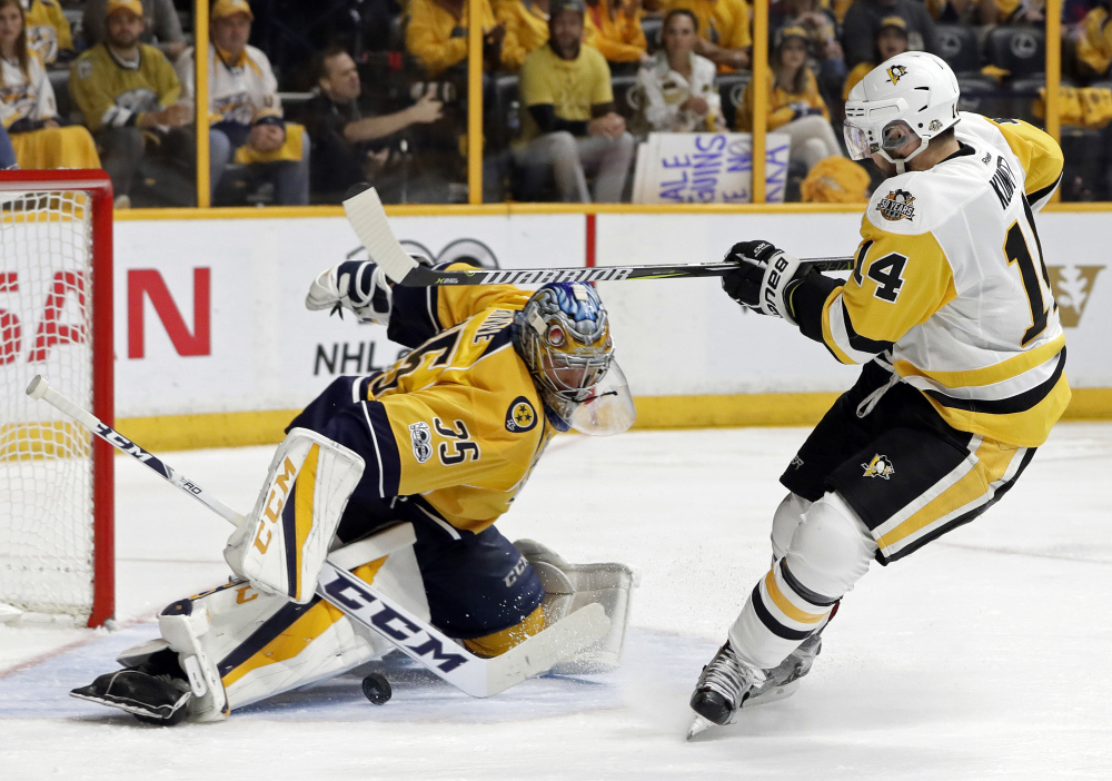 Pekka Rinne stops a shot by Penguins left wing Chris Kunitz in the second period.