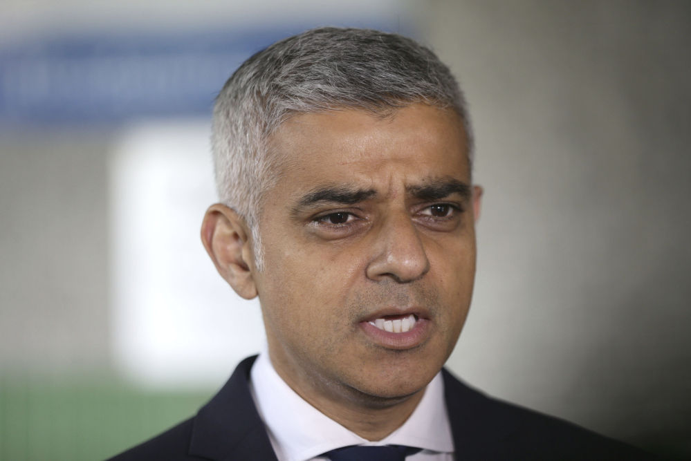Mayor of London Sadiq Khan speaks to the media as he joined London Ambulance workers Tuesday in observing a minute's silence at the London Ambulance Service headquarters at Waterloo, central London.