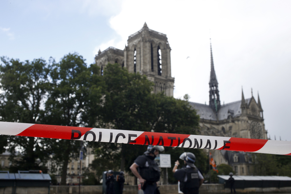 Police officers seal off the access to Notre Dame Cathedral in Paris, France, after a man attacked a police officer there on Tuesday.