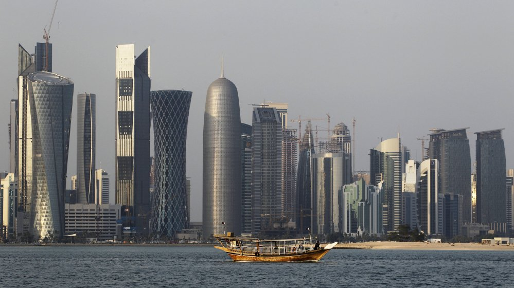 A traditional dhow floats in the Corniche Bay of Doha, Qatar, with tall buildings of the financial district in the background, in this 2011 photo. Qatar is now facing a diplomatic crisis with other Arab nations, which accuse it of backing terror groups and Iran.