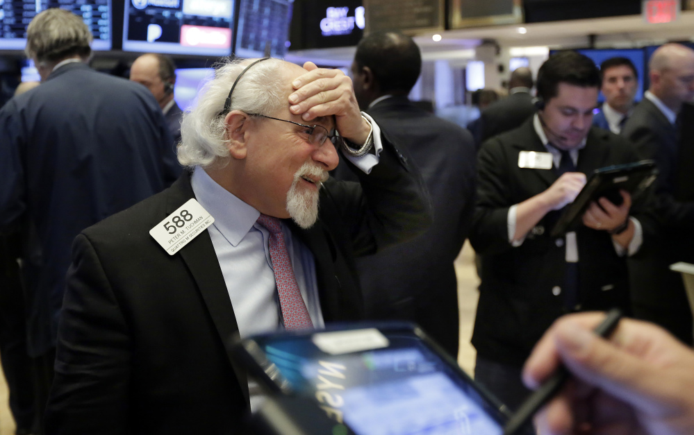 "Trader Peter Tuchman works on the floor of the New York Stock Exchange on Tuesday.  ""This is a market that's taking a breather and is prepared to move, the question is in which direction?"" said Quincy Krosby, a market strategist at Prudential Financial."