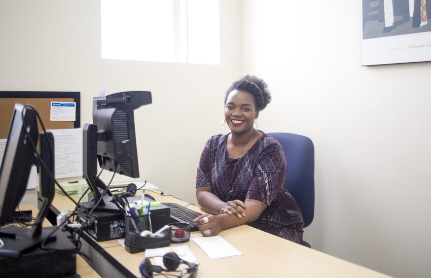 "In exchange for General Assistance, Joanna Nganda translated documents for the city of Portland and manned the front desk of the city's Refugee Services Office, then used that experience to get a job at Greater Portland Health. ""I don't think I would have been able to get this job"" without the work history and local references gained through workfare, she says."
