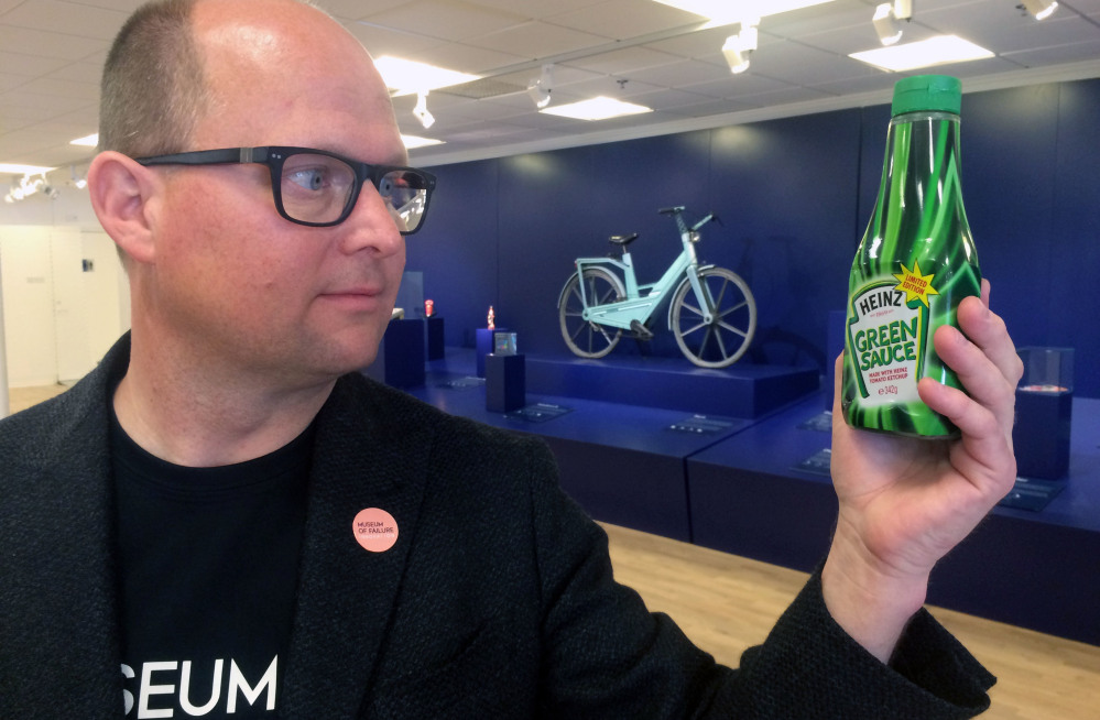 Samuel West holds a bottle of infamous Heinz green tomato ketchup at the Museum of Failure he curates in Helsingborg, Sweden. West says many brands he features want nothing to do with seeing their flops on display.