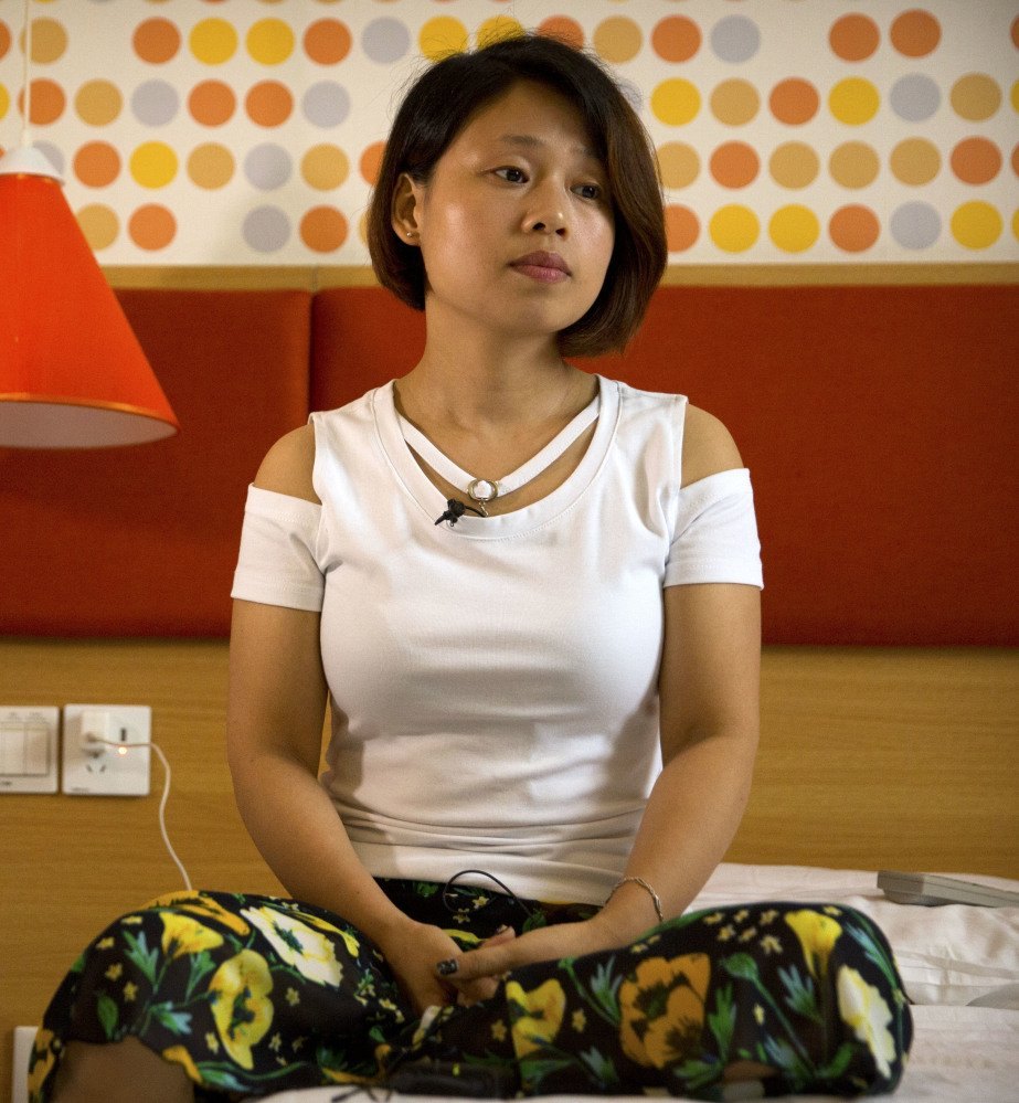 Deng Guilian, the wife of one of the three detainees, says she