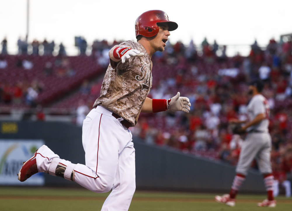 Cincinnati's Scooter Gennett runs the bases after hitting a grand slam off St. Louis pitcher Adam Wainwright on Tuesday night. Gennett hit four home runs and had 10 RBI in the Reds win.