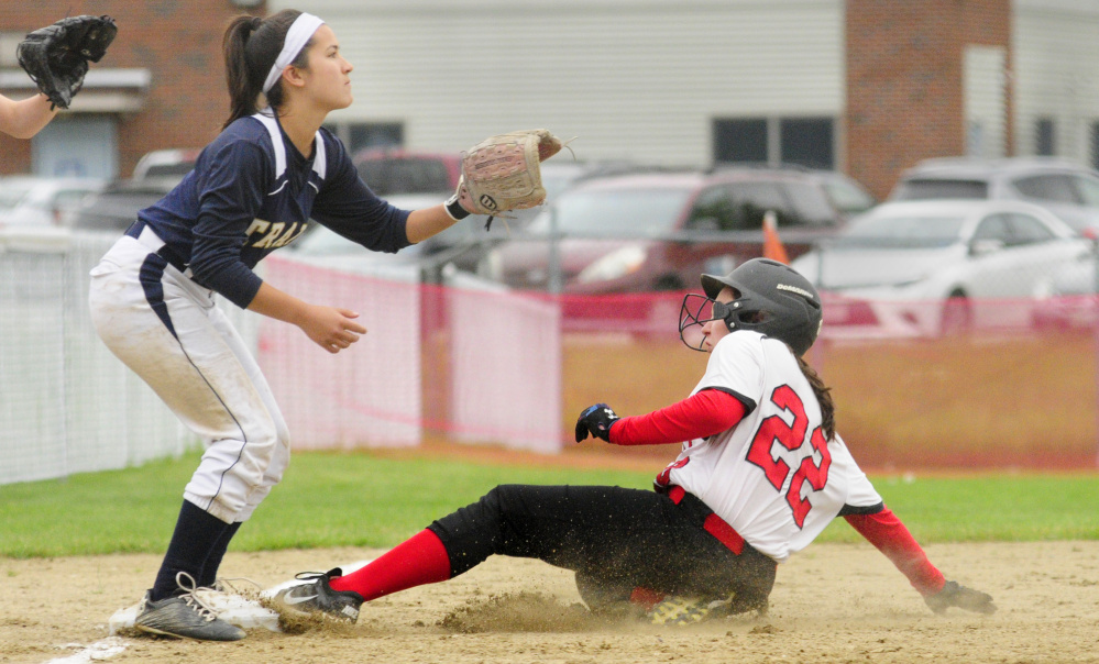 Jill Whynot of Hall-Dale reaches third base on an error Tuesday as Kiara Perez of Traip Academy waits for the throw during the sixth inning of Hall-Dale's 3-0 victory in a Class C South prelim softball game at Farmingdale.