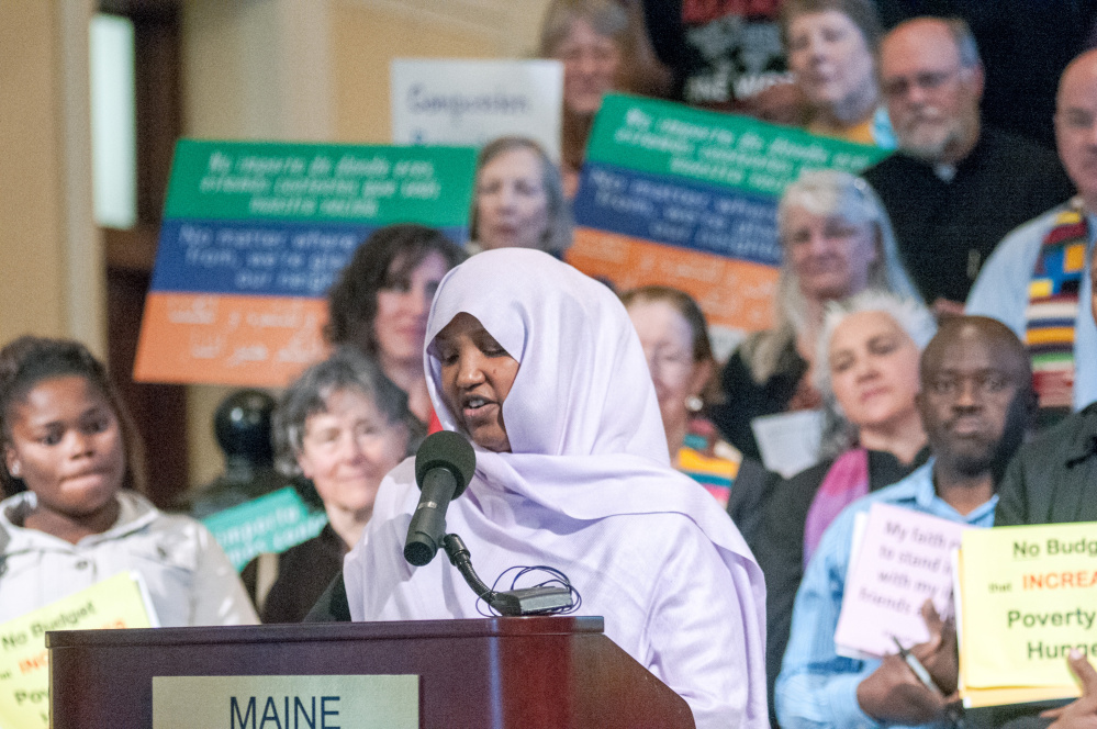 Staff photo by Joe Phelan Fatumah Hussein speaks Wednesday at a rally about immigration led by religious leaders in the State House Hall of Flags in Augusta.