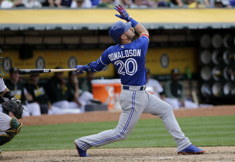 Josh Donaldson of the Toronto Blue Jays hits a two-run, tie-breaking homer during the 10th inning of Wednesday's 7-4 victory at Oakland. With the win, the Jays averted a sweep.