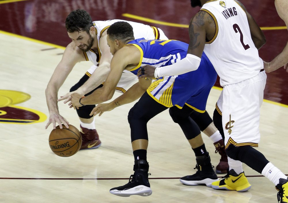 Cavaliers forward Kevin Love, left, defends Golden State's Stephen Curry during the second half of Game 3 of NBA Finals Wednesday night in Cleveland.