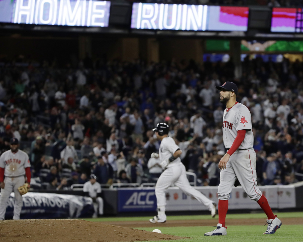 Boston's David Price walks near the mound as New York's Gary Sanchez trots around the bases after hitting a two-run home run in the fifth inning Thursday night in New York. It was Sanchez's second homer of the game.