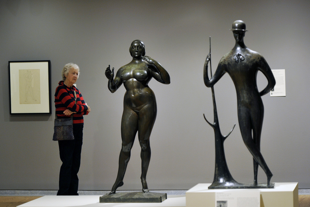"Claire Keyes of Marblehead, Massachusetts, studies ""Standing Woman,"" by Gaston Lachaise. At right, ""Man in the Open Air,"" by Elie Nadelman. Below, ""Spirit of the Dance,"" by William Zorach."