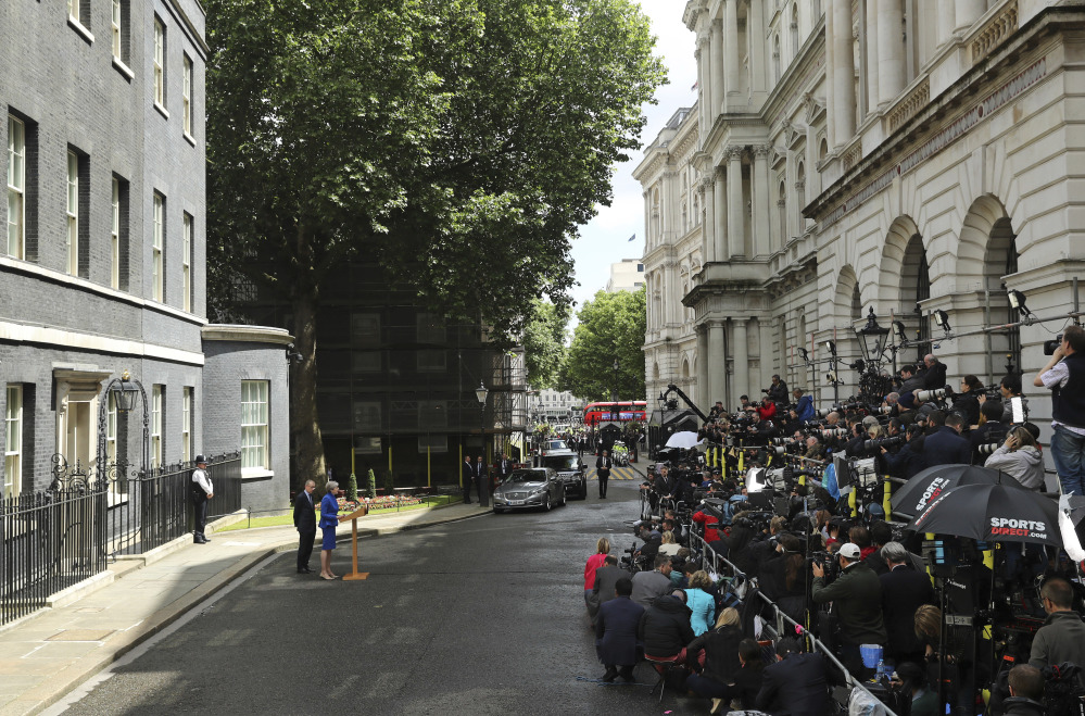 """British Prime Minister Theresa May, speaking to the press outside 10 Downing St., London, on Friday, scarcely acknowledged Thursday's election's disastrous outcome, promising to form """"a government that can provide certainty."""""""