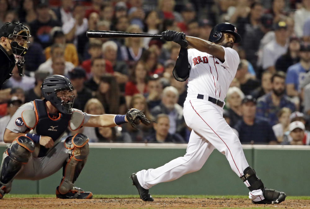 Boston's Jackie Bradley Jr. hits a two-run home run in the eighth inning Friday night at Fenway Park.