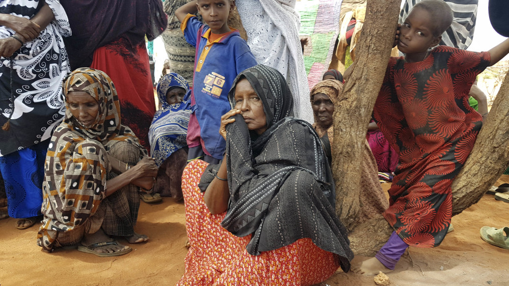 Ader Ali Yusuf, center, a mother of 12 who was displaced from her village because of the ongoing drought in Ethiopia, sits among a group of women and children Friday in a town near Ethiopia's border with Somalia.