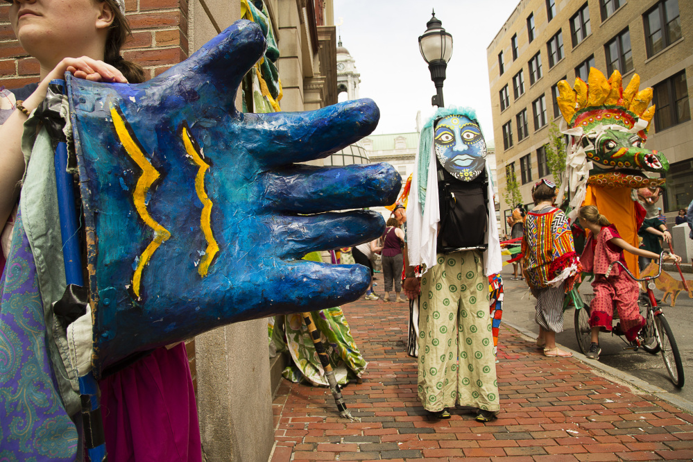 In this 2017 photo, Old Port Festival characters wait for the start of the parade on Exchange Street.