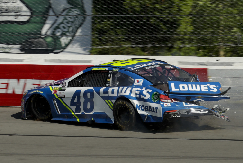 Jimmie Johnson crashes into the wall after experiencing brake problems. Johnson wasn't injured, but he finished 36th.