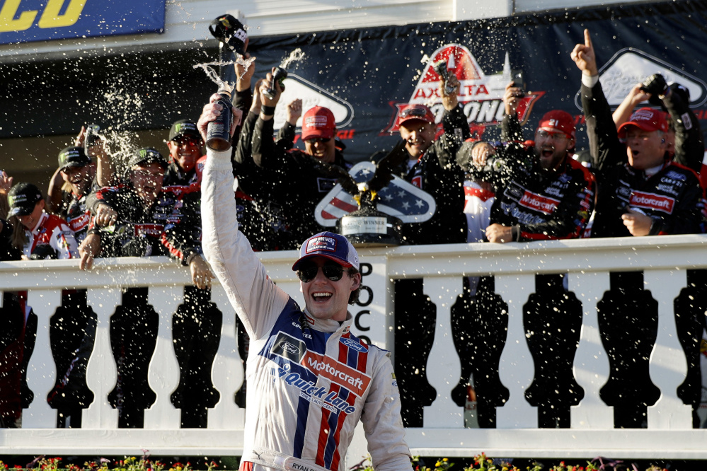 Ryan Blaney celebrates after his Cup Series victory Sunday at Pocono Raceway. Blaney took the lead from Kyle Busch late in the race and held on for his first career win in 68 races.
