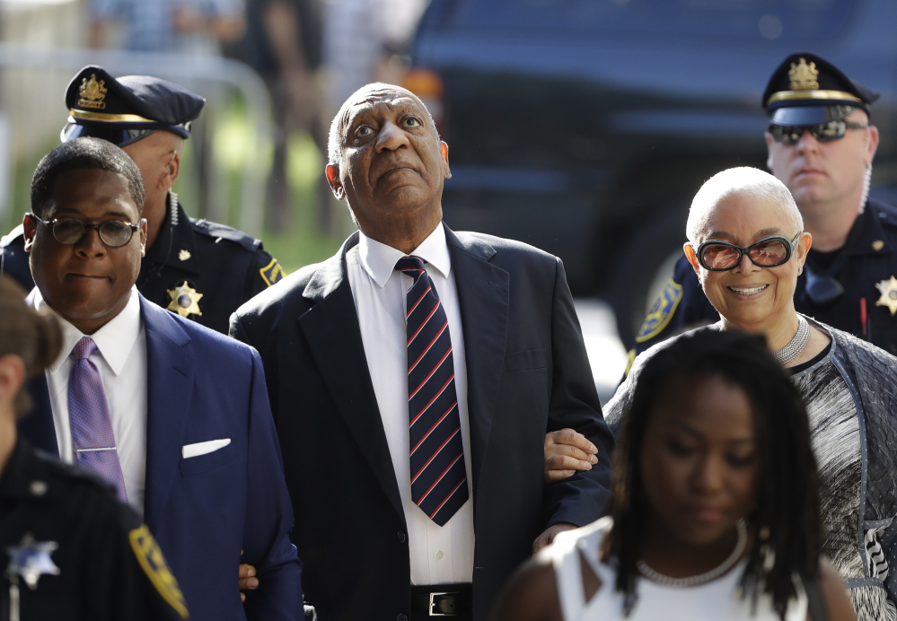 Bill Cosby arrives for his sexual assault trial Monday with his wife, Camille Cosby, right, at the Montgomery County Courthouse in Norristown, Pa. Cosby did not testify, as the defense case took just minutes.