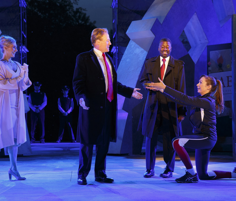 Tina Benko, left, portrays Melania Trump in the role of Caesar's wife, Calpurnia, and Gregg Henry, center left, portrays President Trump in the role of Julius Caesar.