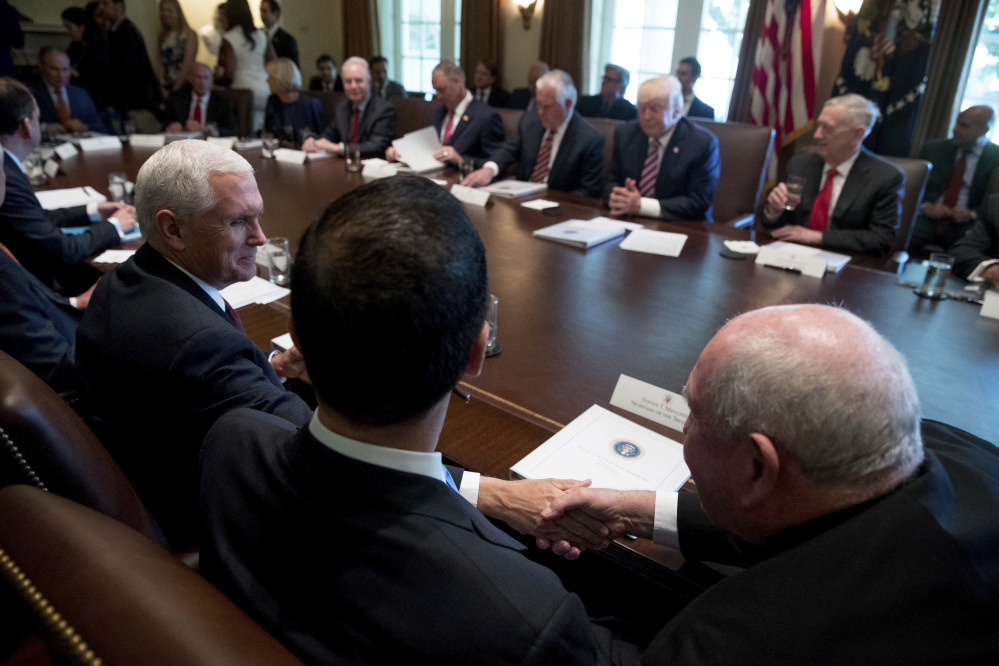 Vice President Pence, left, shakes hands with Agriculture Secretary Sonny Perdue during President Trump's Cabinet meeting Monday at the White House. The meeting came as the White House struggles to advance its agenda.