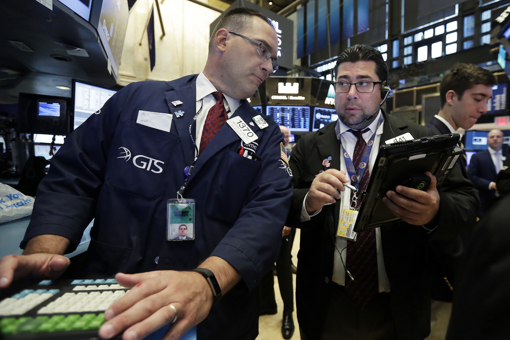 Specialist Anthony Matesic, left, and trader Michael Capolino work on the floor of the New York Stock Exchange, Monday, June 12, 2017. (AP Photo/Richard Drew)