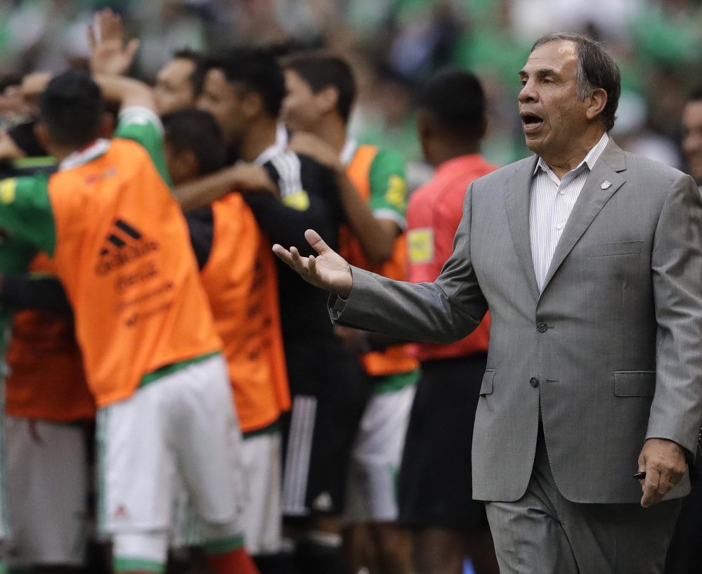 U.S. Coach Bruce Arena hands out credit to the players, who apparently have responded well to his methods, climbing from last to third in the final round of World Cup qualifying.