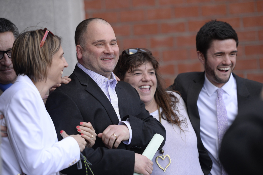 Anthony Sanborn Jr. celebrates with his family, friends and attorneys after leaving the Cumberland County Jail on bail April 13.